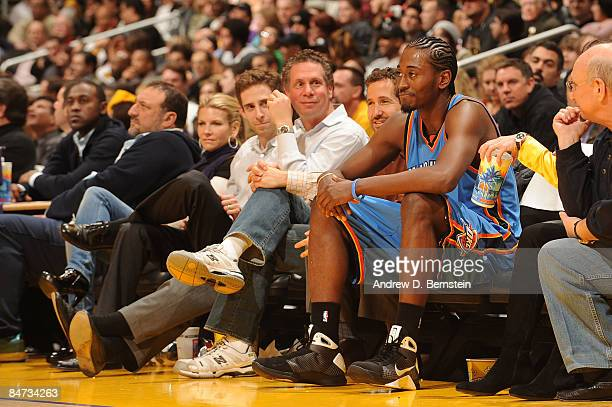 Kyle Weaver of the Oklahoma City Thunder sits among fans after going out of bounds during a game against the Los Angeles Lakers at Staples Center on...