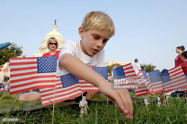 Kyle Weis from Oak Hill VA plays with Star Wars action figures on the west front lawn of the US Capitol while he and his mother Ann Marie Weis wait...