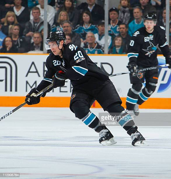 Kyle Wellwood of the San Jose Sharks handles the puck against the Los Angeles Kings in Game One of the Western Conference Quarterfinals during the...