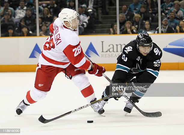 Kyle Wellwood of the San Jose Sharks tries to stop Brian Rafalski of the Detroit Red Wings in Game Five of the Western Conference Semifinals during...