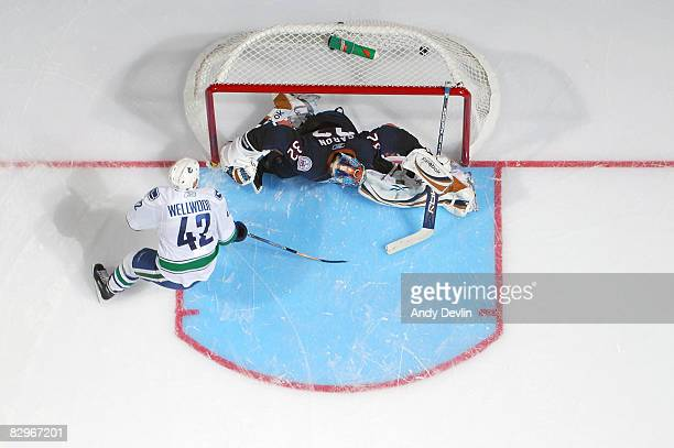 Kyle Wellwood of the Vancouver Canucks scores a shootout goal on Mathieu Garon of the Edmonton Oilers during a preseason game on September 22 2008 at...