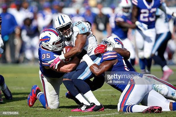Kyle Williams and Jerry Hughes of the Buffalo Bills tackle Bishop Sankey of the Tennessee Titans in the second half at Nissan Stadium on October 11...