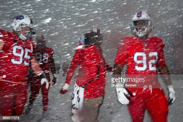 Kyle Williams Deandre Coleman and Adolphus Washington of the Buffalo Bills warm up before a game against the Indianapolis Colts on December 10 2017...
