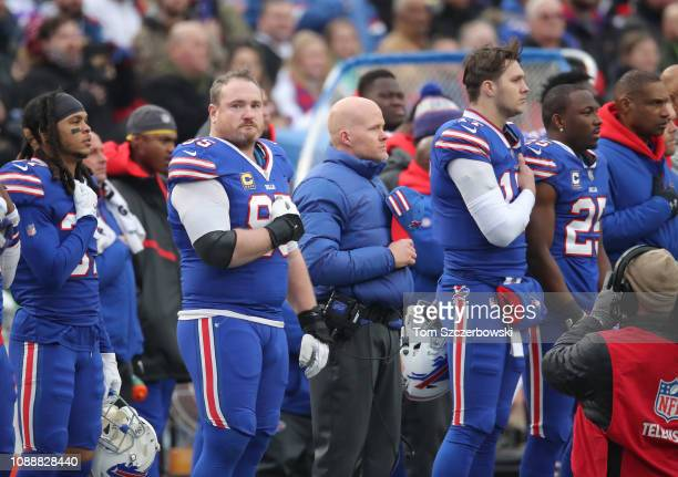 Kyle Williams of the Buffalo Bills and head coach Sean McDermott and Josh Allen and LeSean McCoy stand for the singing of the American national...
