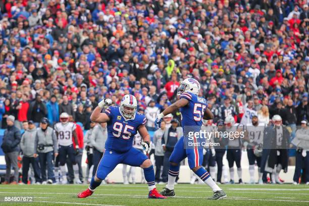 Kyle Williams of the Buffalo Bills and Jerry Hughes of the Buffalo Bills celebrate during the second quarter after Williams sacked Tom Brady of the...