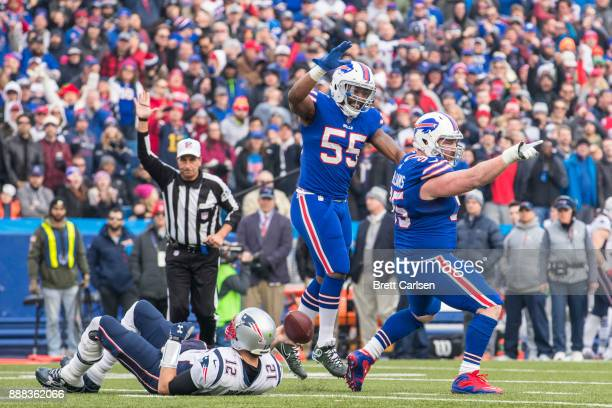 Kyle Williams of the Buffalo Bills celebrates a sack against Tom Brady of the New England Patriots during the second quarter at New Era Field on...