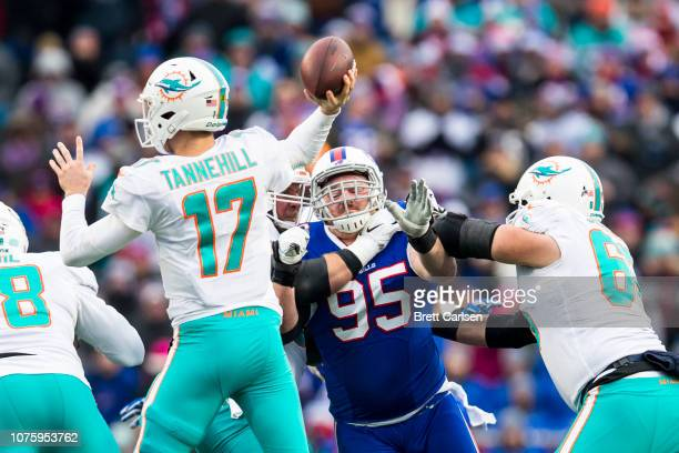 Kyle Williams of the Buffalo Bills pressures Ryan Tannehill of the Miami Dolphins during the second quarter at New Era Field on December 30 2018 in...