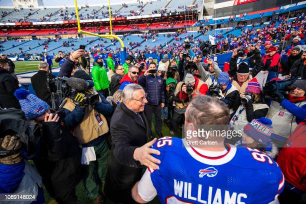 Kyle Williams of the Buffalo Bills shakes hands with Buffalo Bills owner Terry Pegula following his final game at New Era Field on December 30 2018...