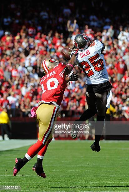 Kyle Williams of the San Francisco 49ers keeps Aqib Talib of the Tampa Bay Buccaneers from intercepting this pass in the third quarter during an NFL...