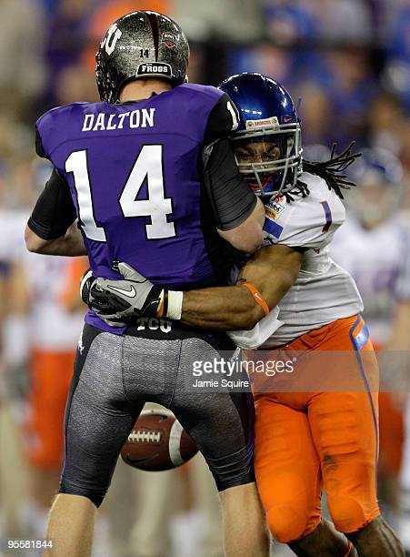 Kyle Wilson of the Boise State Broncos sacks quarterback Andy Dalton of the TCU Horned Frogs as Dalton looses the ball but it was recovered by a...