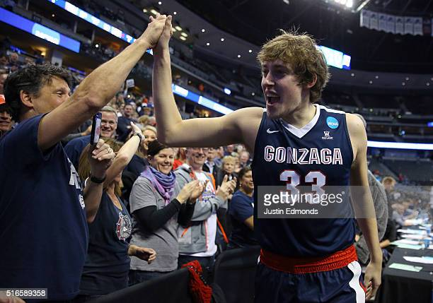 Kyle Wiltjer of the Gonzaga Bulldogs celebrates with fans after defeating the Utah Utes with a score of 82 to 59 during the second round of the 2016...