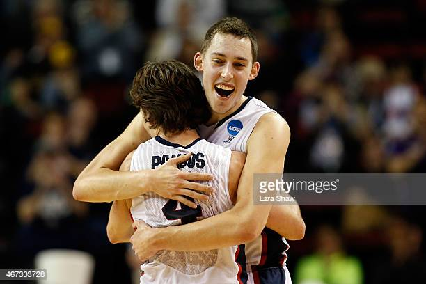 Kyle Wiltjer of the Gonzaga Bulldogs celebrates with Kevin Pangos after defeating the Iowa Hawkeyes 87 to 68 during the third round of the 2015 NCAA...
