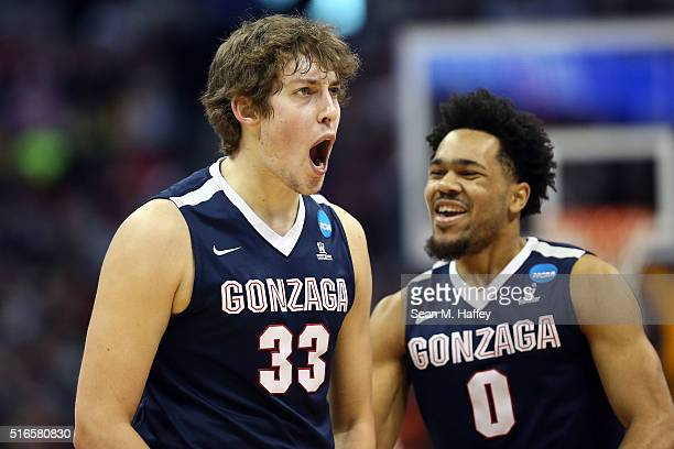 Kyle Wiltjer of the Gonzaga Bulldogs celebrates with teammate Silas Melson in the first half against the Utah Utes during the second round of the...