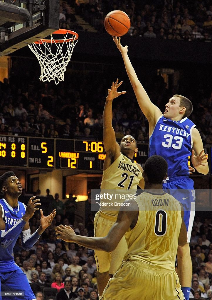 Kyle Wiltjer #33 of the Kentucky Wildcats takes a shot over Sheldon Jeter #21 and Rod Odom #0 of the Vanderbilt Commodores at Memorial Gym on January 10, 2013 in Nashville, Tennessee.