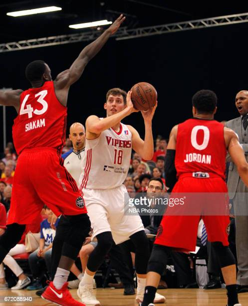 Kyle Wiltjer of the Rio Grande Valley Vipers looks for a shot as Pascal Siakam and John Jordan of the Raptors 905 defend during the first game of the...