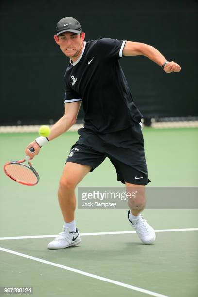 Kyle Wolf of the Bowdoin Polar Bears hits a forehand against the Middlebury Panthers during the Division III Men's Tennis Championship held at the...