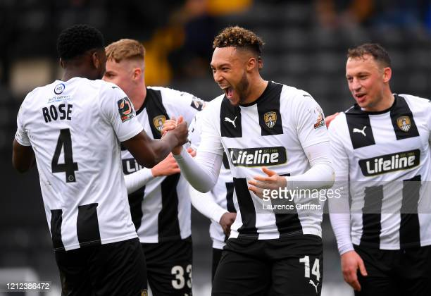 Kyle Wootton of Notts County celebrates with Mitch Rose after scoring his team's third goal during the Vanarama National League match between Notts...