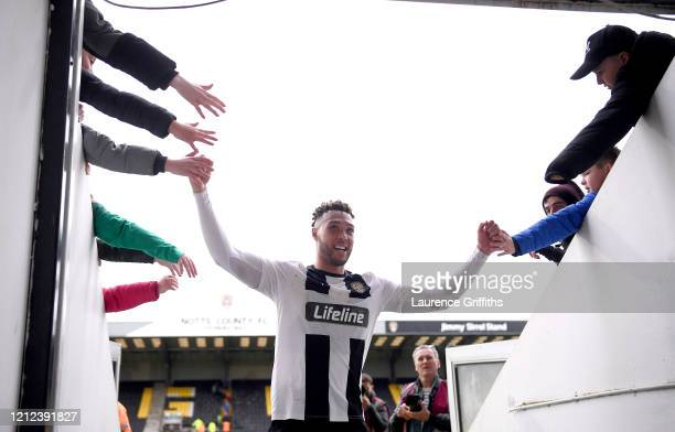 Kyle Wootton of Notts County high fives fans as he walks off after the Vanarama National League match between Notts County and Eastleigh at Meadow...