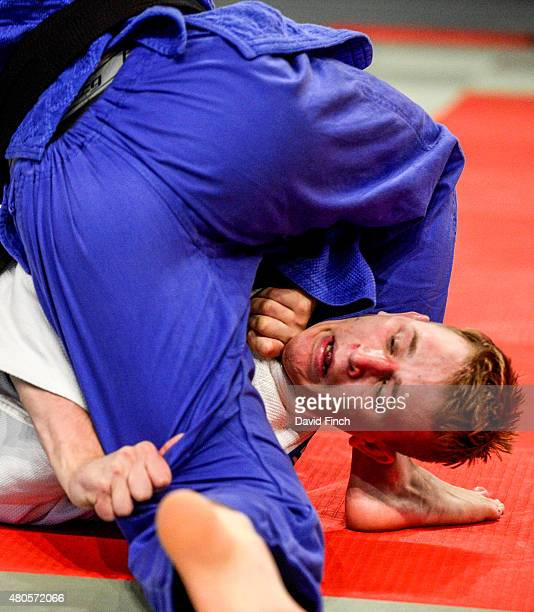 Kyle Wright of the USA attempts to strangle Olle Mattsson of Sweden into submission in their u81kg contest which was won by Mattsson on his way to...
