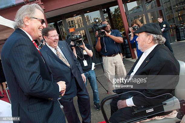Kyle Young and Joe Turner greet Mac Wiseman as he arrives at the 2014 Country Music Hall of Fame induction ceremony at Country Music Hall of Fame and...
