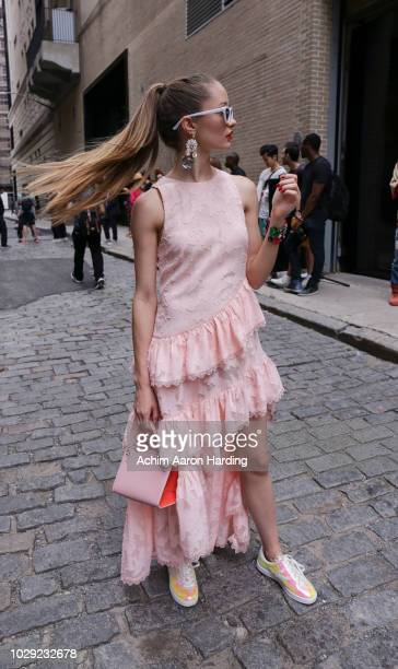 Kyleigh McCollam is seen wearing a pink Elliatt dress and pink purse on the street during New York Fashion Week on September 7 2018 in New York City