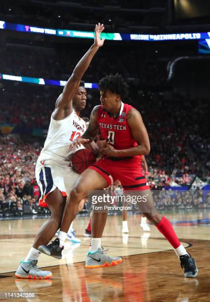 Kyler Edwards of the Texas Tech Red Raiders drives to the basket against De'Andre Hunter of the Virginia Cavaliers in the second half during the 2019...