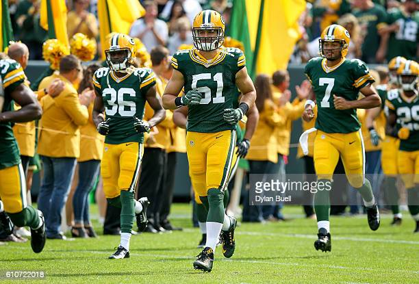 Kyler Fackrell of the Green Bay Packers jogs onto the field before the game against the Detroit Lions at Lambeau Field on September 25 2016 in Green...