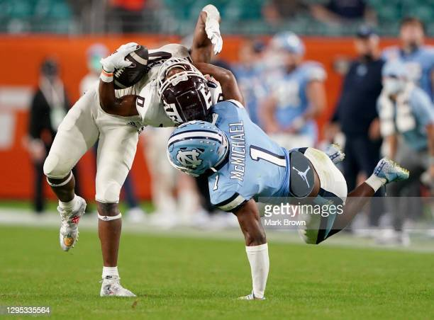 Kyler McMichael of the North Carolina Tar Heels tackles Ainias Smith of the Texas A&M Aggies during the second half of the Capital One Orange Bowl at...