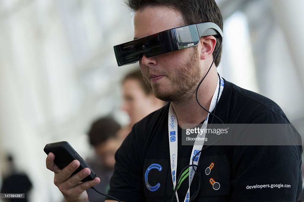 Kyler Miller tries out the Moverio BT-100 see-through wearable display made by Seiko Epson Corp. during the Google I/O conference in San Francisco, California, U.S., on Thursday, June 28, 2012. Google Inc., owner of the world's most popular search engine, unveiled a cloud-computing service for building and running applications to help woo customers and challenge Amazon.com Inc.'s Web Services. Photographer: David Paul Morris/Bloomberg via Getty Images