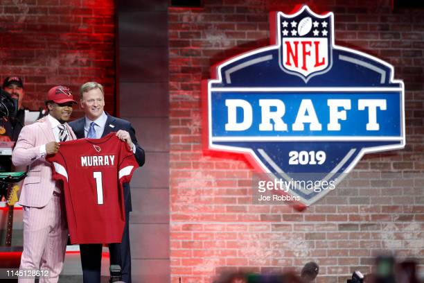 Kyler Murray of Oklahoma with NFL commissioner Roger Goodell after being announced as the first pick in the first round of the NFL Draft on April 25,...