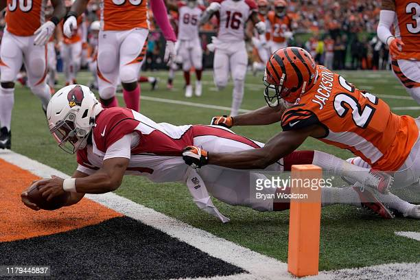 Kyler Murray of the Arizona Cardinals dives into the end zone for a touchdown during the first quarter of the NFL football game against the...