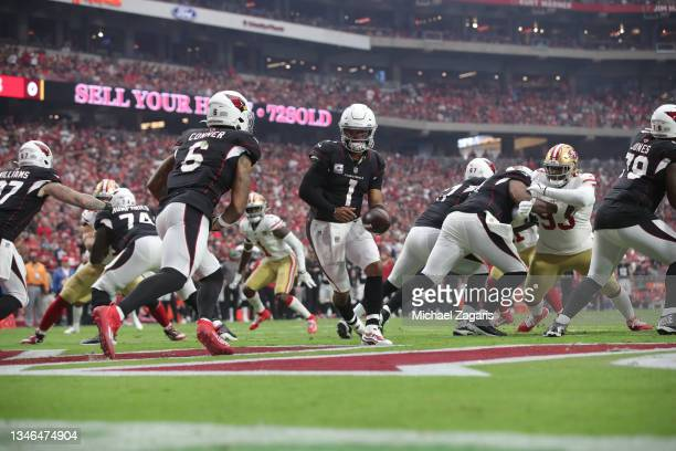 Kyler Murray of the Arizona Cardinals hands the ball off during the game against the San Francisco 49ers at State Farm Stadium on October 10, 2021 in...