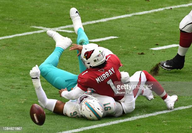 Kyler Murray of the Arizona Cardinals is sacked by Emmanuel Ogbah of the Miami Dolphins during the first half at State Farm Stadium on November 08,...