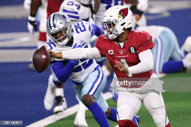 Kyler Murray of the Arizona Cardinals runs for a touchdown against Xavier Woods of the Dallas Cowboys during the third quarter at AT&T Stadium on...