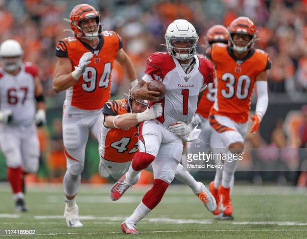 Kyler Murray of the Arizona Cardinals runs the ball late in the fourth quarter to set up the game the winning field goal as Clayton Fejedelem of the...