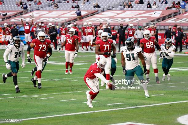 Kyler Murray of the Arizona Cardinals scores a rushing touchdown against the Philadelphia Eagles during the first quarter at State Farm Stadium on...