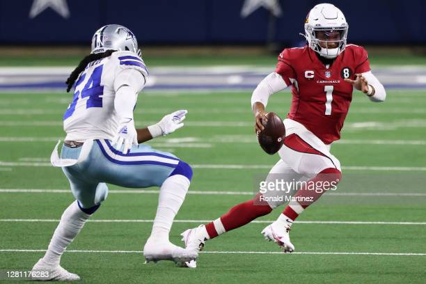Kyler Murray of the Arizona Cardinals scrambles against Jaylon Smith of the Dallas Cowboys during the first quarter at AT&T Stadium on October 19 in...