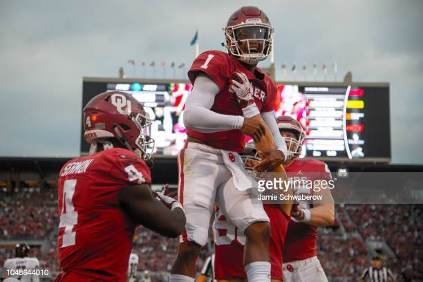 Kyler Murray of the Oklahoma Sooners celebrates a touchdown against the Army West Point Black Knights at Gaylord FamilyOklahoma Memorial Stadium on...