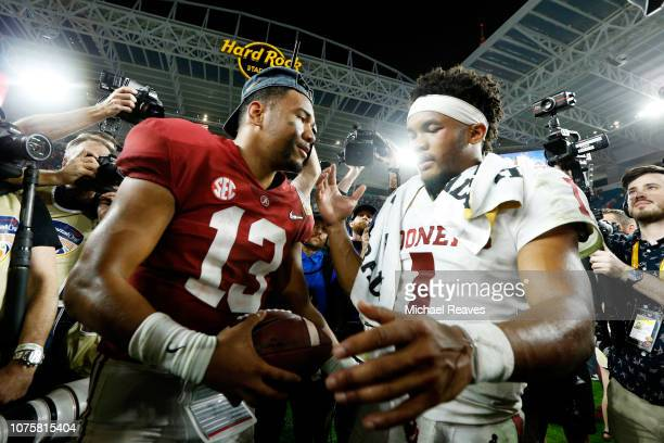 Kyler Murray of the Oklahoma Sooners congratulates Tua Tagovailoa of the Alabama Crimson Tide after the Alabama Crimson Tide defeat the Oklahoma...