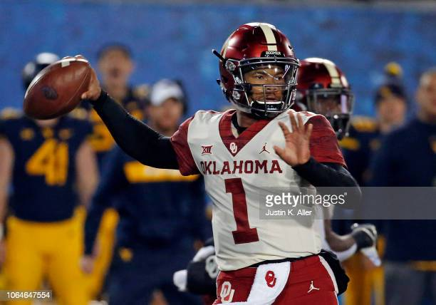 Kyler Murray of the Oklahoma Sooners passes in the first half against the West Virginia Mountaineers on November 23 2018 at Mountaineer Field in...