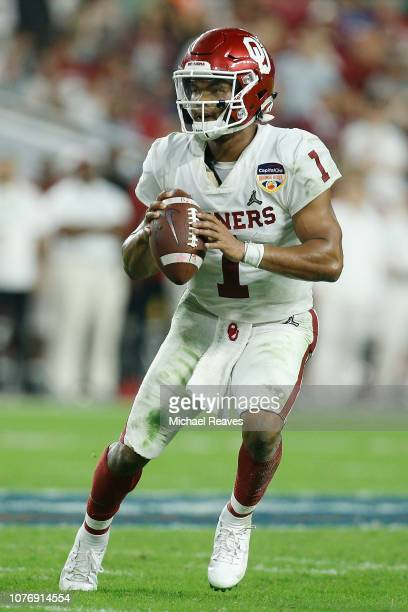 Kyler Murray of the Oklahoma Sooners scrambles with the ball against the Alabama Crimson Tide during the College Football Playoff Semifinal at the...