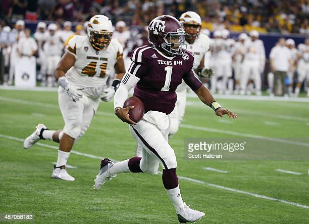 Kyler Murray of the Texas A&M Aggies runs upfield in the first half of their game against the Arizona State Sun Devils during the Advocare Texas...
