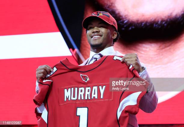 Kyler Murray Oklahoma reacts after he was picked overall by the Arizona Cardinals during the first round of the 2019 NFL Draft on April 25 2019 in...