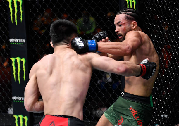 Kyler Phillips punches Song Yadong of China in their bantamweight fight during the UFC 259 event at UFC APEX on March 06, 2021 in Las Vegas, Nevada.