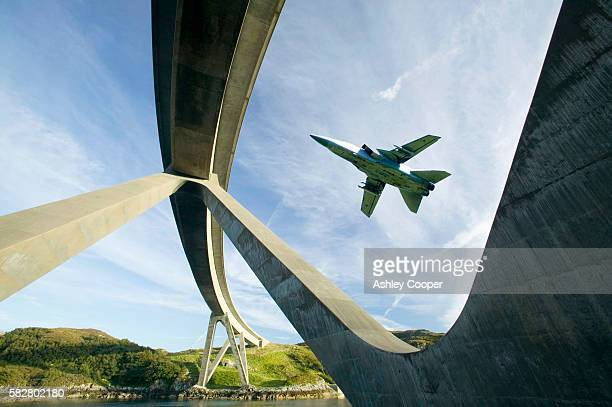 kylesku bridge in assynt scotland uk, with an raf jet flying past. - british military stock pictures, royalty-free photos & images