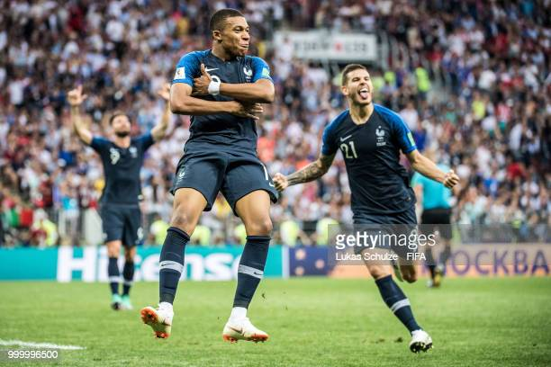 Kylian Mbappé and Lucas Hernandez of France celebrate their treams fourth goal during the 2018 FIFA World Cup Russia Final between France and Croatia...