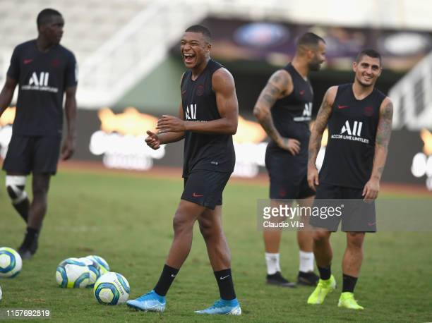 Kylian Mbappé and Marco Verratti of PSG smile during a training session on July 26 2019 in Macau