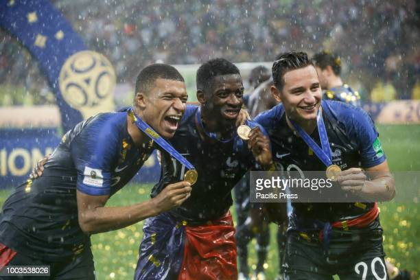 Kylian Mbappé of France Adil Rami of France and Florian Thauvin of France celebrate the 2018 World Cup title after a 42 win against Croatia at the...