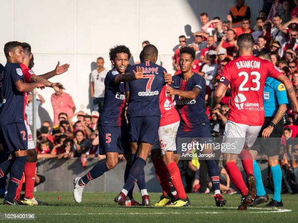 Kylian Mbappé of Paris SaintGermain react before receive a red card during the Ligue 1 match between Paris SaintGermain and Nimes Olympique at Stade...