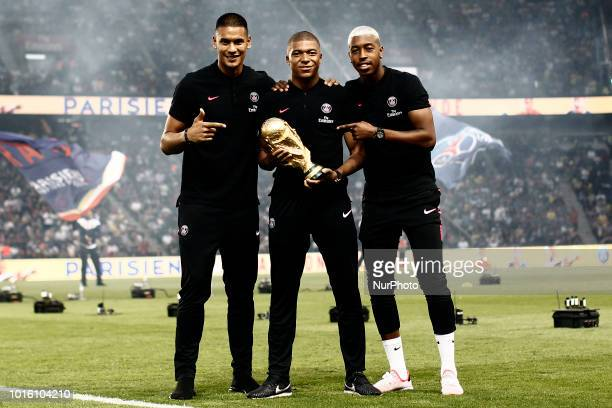 Kylian Mbappe Alphonse Areola Presnel Kimpembe poses and holds the 2018 World Cup Trophy prior to the French L1 football match between Paris...